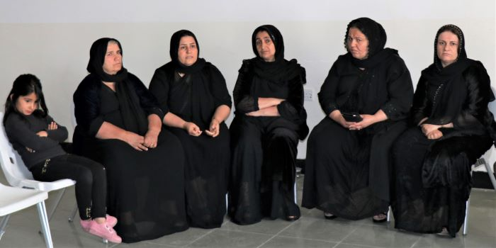 The wives, mothers and daughter of those killed and missing in Deraluk