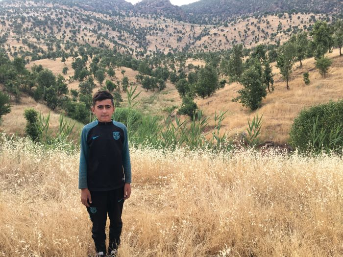 Aihan was looking after his family's flock of sheep when the Turkish bombing began.