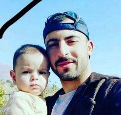Himda'at Othman with his son.