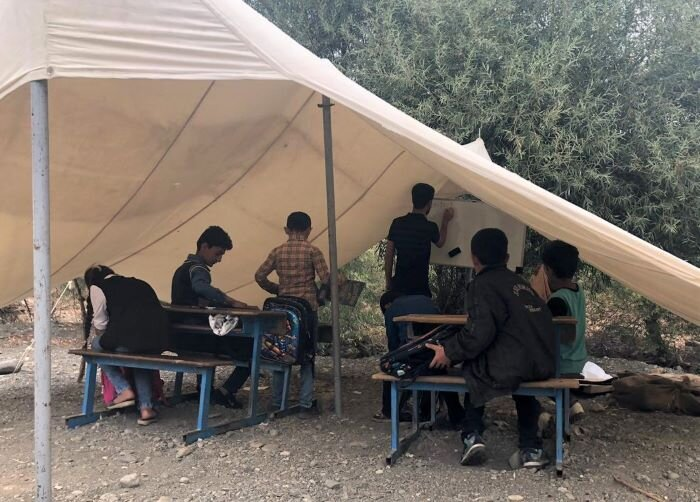 Displaced students from Zewka, try to keep up with their studies in desperate conditions.