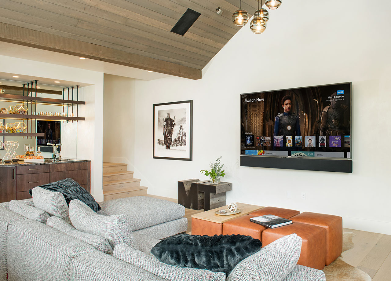 """4k Home Entertainment - When it comes to your home entertainment, we won't accept anything less than exceptional experiences. Combining stunning image quality with leading-edge sound, our integrations will deliver a memorable impression. Your user experience is also a priority of ours. We offer only top-of-the-line products and unlimited personalization. Browse content from one source or various sources, search and find movies and shows quickly and easily with intuitive control, from smart remotes to your smart phone, or even by voice. Get handpicked recommendations, live sports, and news without switching from one service to the next. Find feature films, season episodes, concerts, and documentaries from all the major motion picture studios and the most creative independents out there. Our knowledge and expertise in AV will not let you down.Pictured: Samsung 75"""" 4k TV, Leon Sound-bar with In-Ceiling 5.1 surround + rear sub, and Apple TV"""