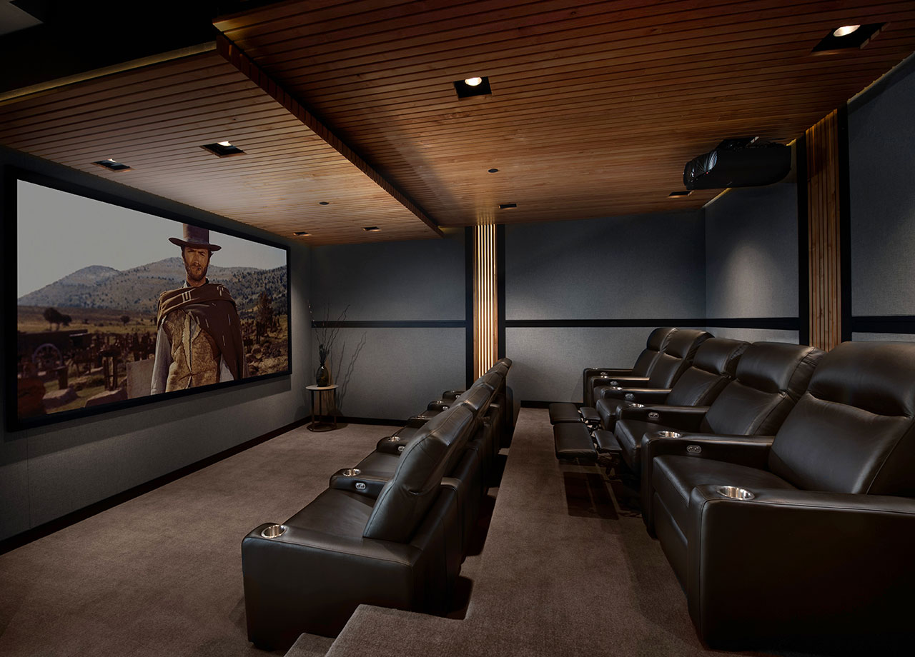 Home Theater - At SAV Digital Environments, our team of experts can design, install, and manage a home theater that will give you, your family, and your guests unforgettable movie nights, sporting events, and so much more. The options are almost endless. From the proper automation control, lighting, climate, and power management to the audio-video system, screen, and projector, we will bring the cinema to you.Pictured: 105