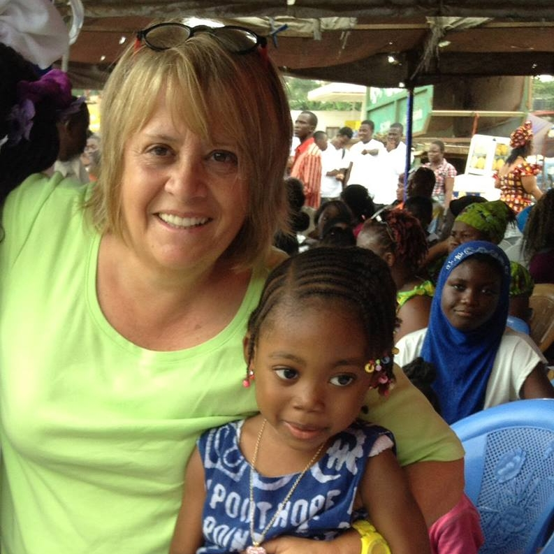 Donna Sperone in Ghana with her young friend, Charleslynn