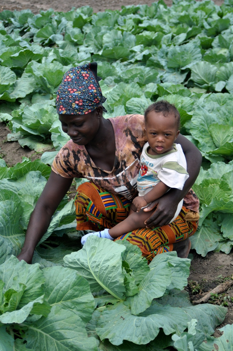 Mama student with her child in cabbage.jpg