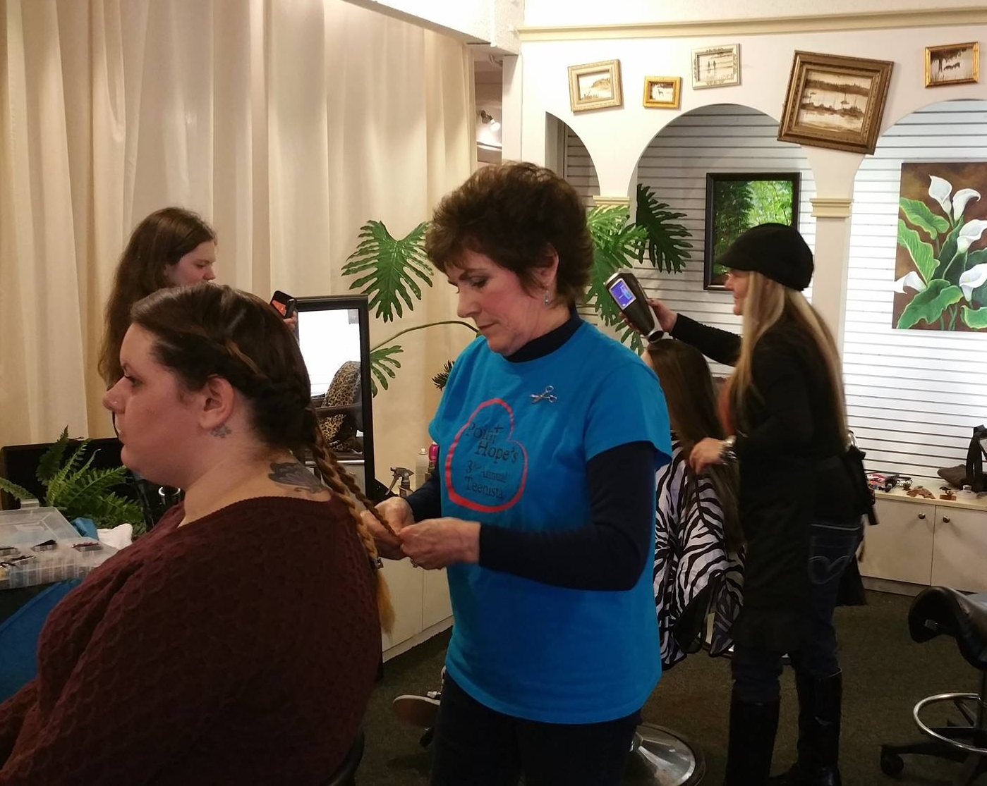 """The """"Hairstyling Station"""" is probably the MOST favorite station in the entire day. Young ladies get cuts, styles and up-dos, plus they may receive a card with future appointments for the year--something they often cannot afford or don't have access to in their """"real world"""" experience."""