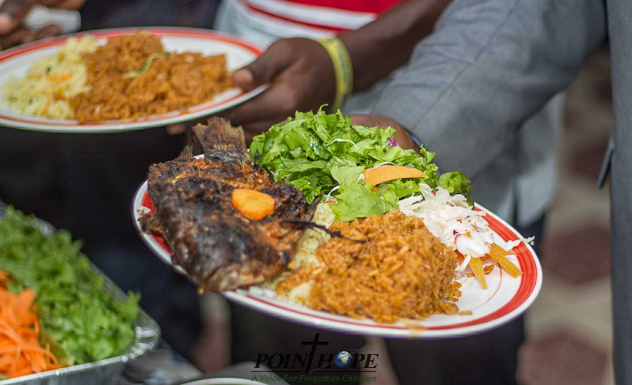 Grilled tilapia, Jollof Rice, and salad (which you should only eat from a place the PHG staff recommends).