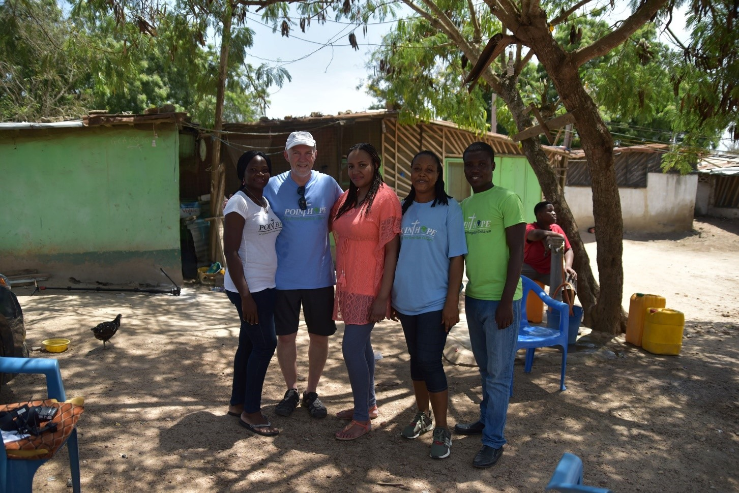 At one of the 25 water fetching stations that make up the Point Hope Living Water Project.    Pictured L-R: Ida Boateng-Asare (PHG Volunteer & Beneficiary Coordinator), Ron Finney (volunteer videographer/photograper), Me (Kate), Kabeh Myers (Living Water Supervisor and water vendor), Prince Owusu (PHG Driver)