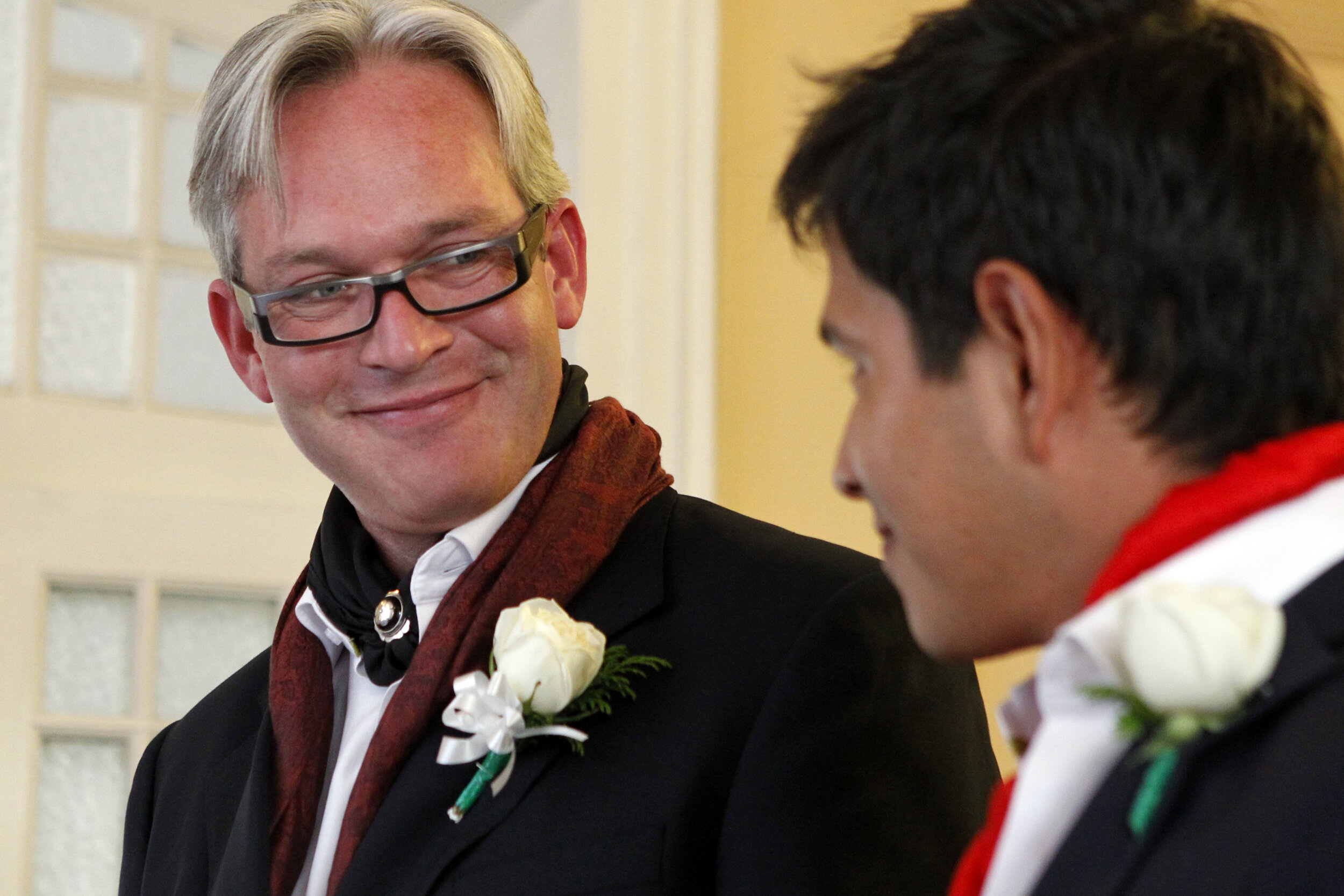 Patrick Dove/Standard-TimesJ.W. Lown gives a smile to his same-sex partner as they stand before the judge at their Wedding in November at the Hotel Casa Gonzalez in Mexico City. Lown gave up his fourth term as the mayor of San Angelo to move to Mexico with his partner in 2009.shot 11.16.13 archived 12.06.13