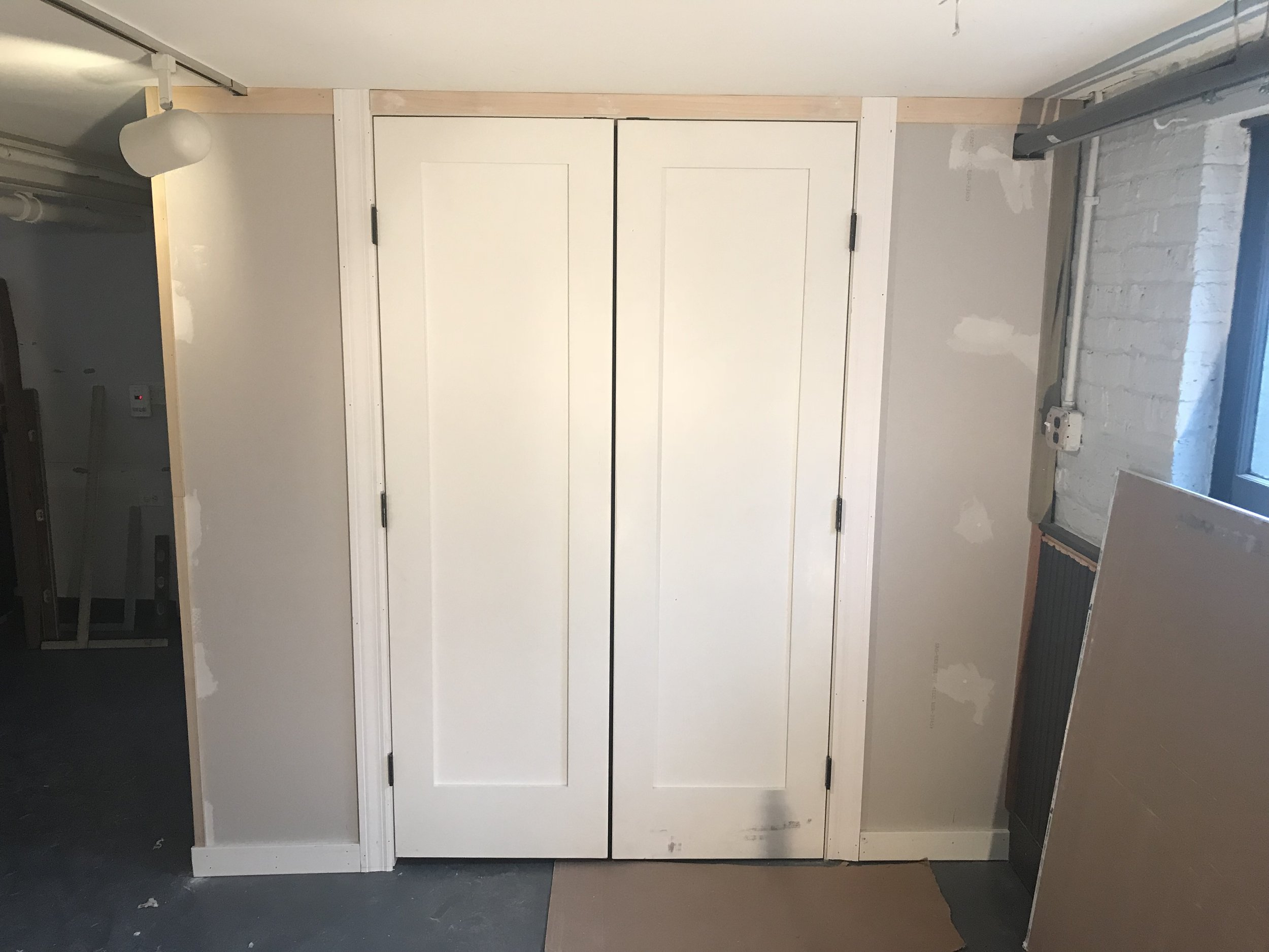 This is where my dad comes in. While Mike and I were on our babymoon in Palm Springs, he built us this closet that was deep enough for the baby stuff that needed to be behind closed doors.