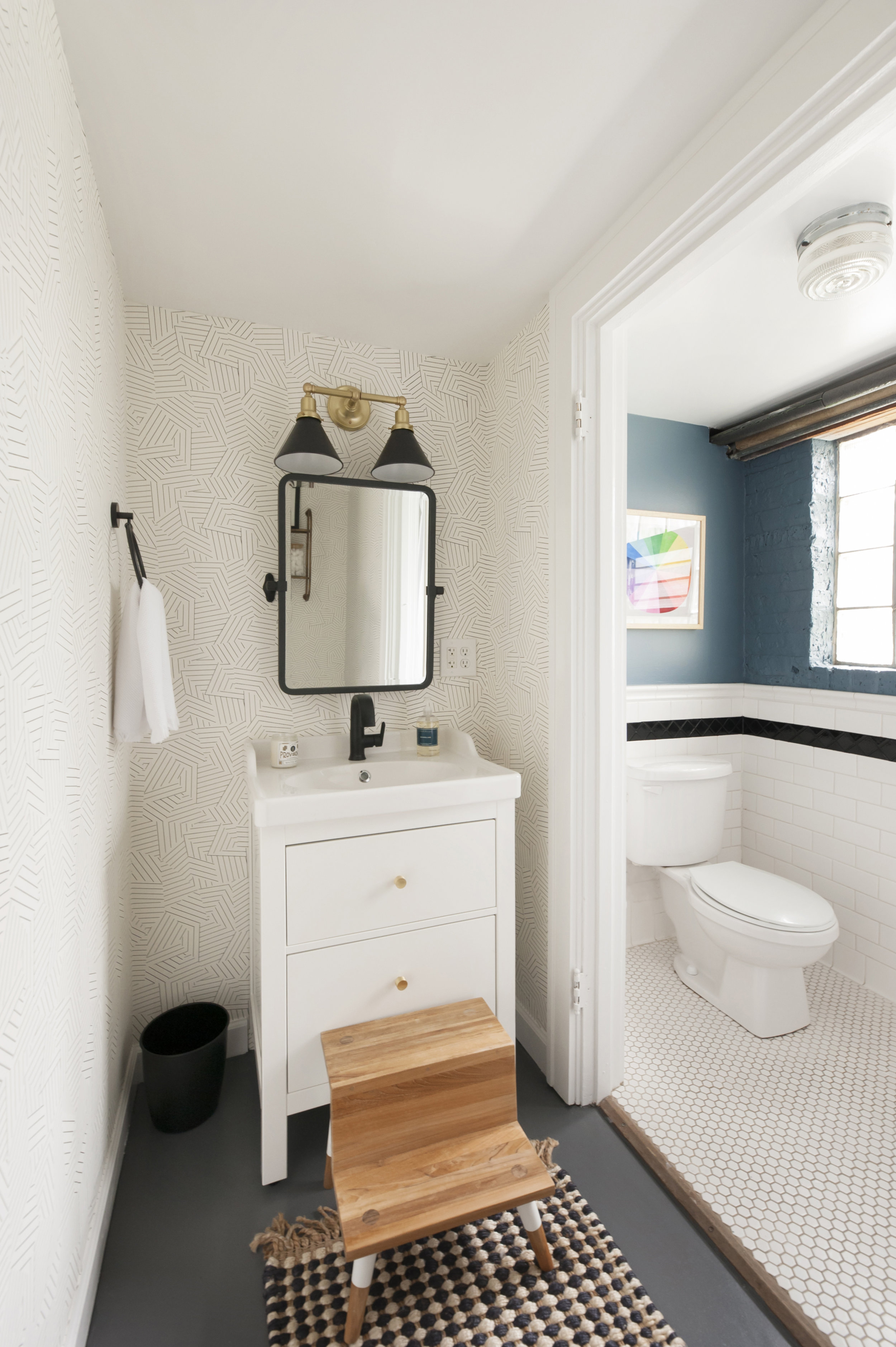 Adding a playful, geometric wallpaper, a new vanity, new lighting and plumbing fixtures really brought it together!
