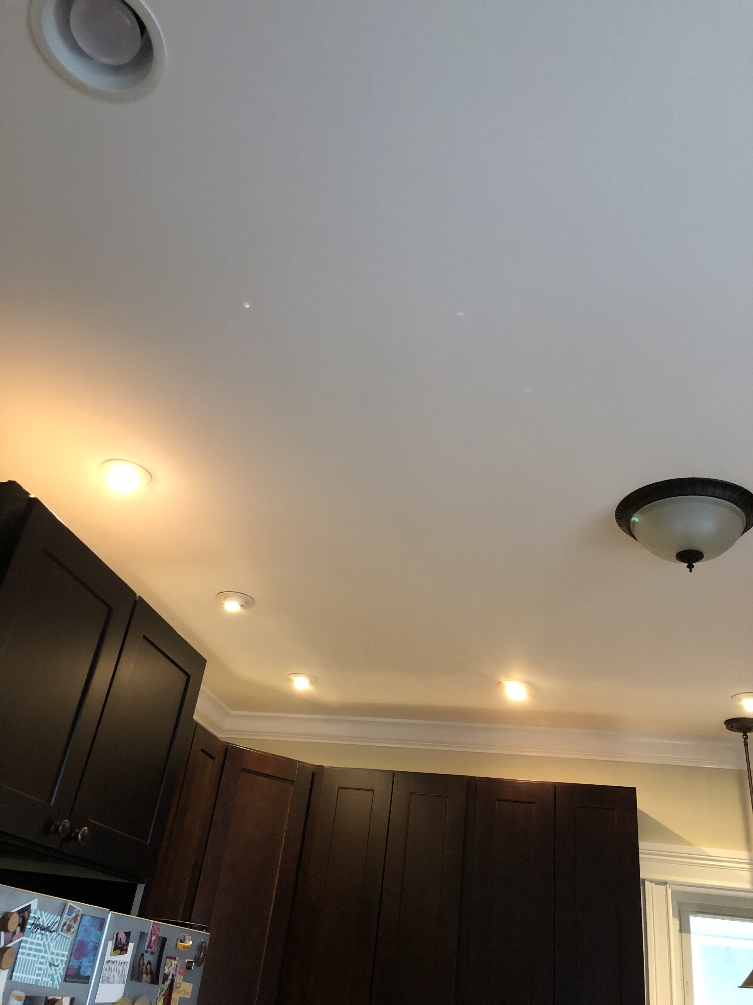 The can lighting was poorly laid out and didn't actually illuminate anything other than the top of the cabinets.