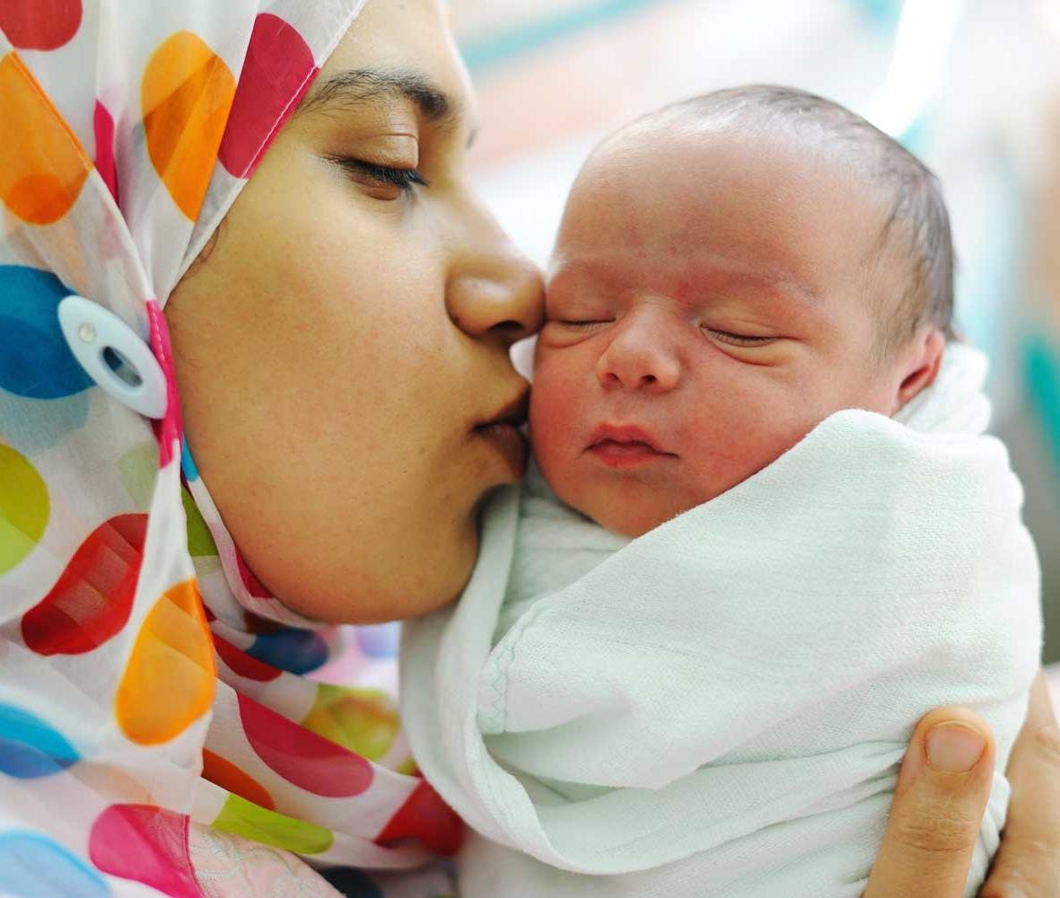 muslim-woman-kissing-baby_for-web.jpg