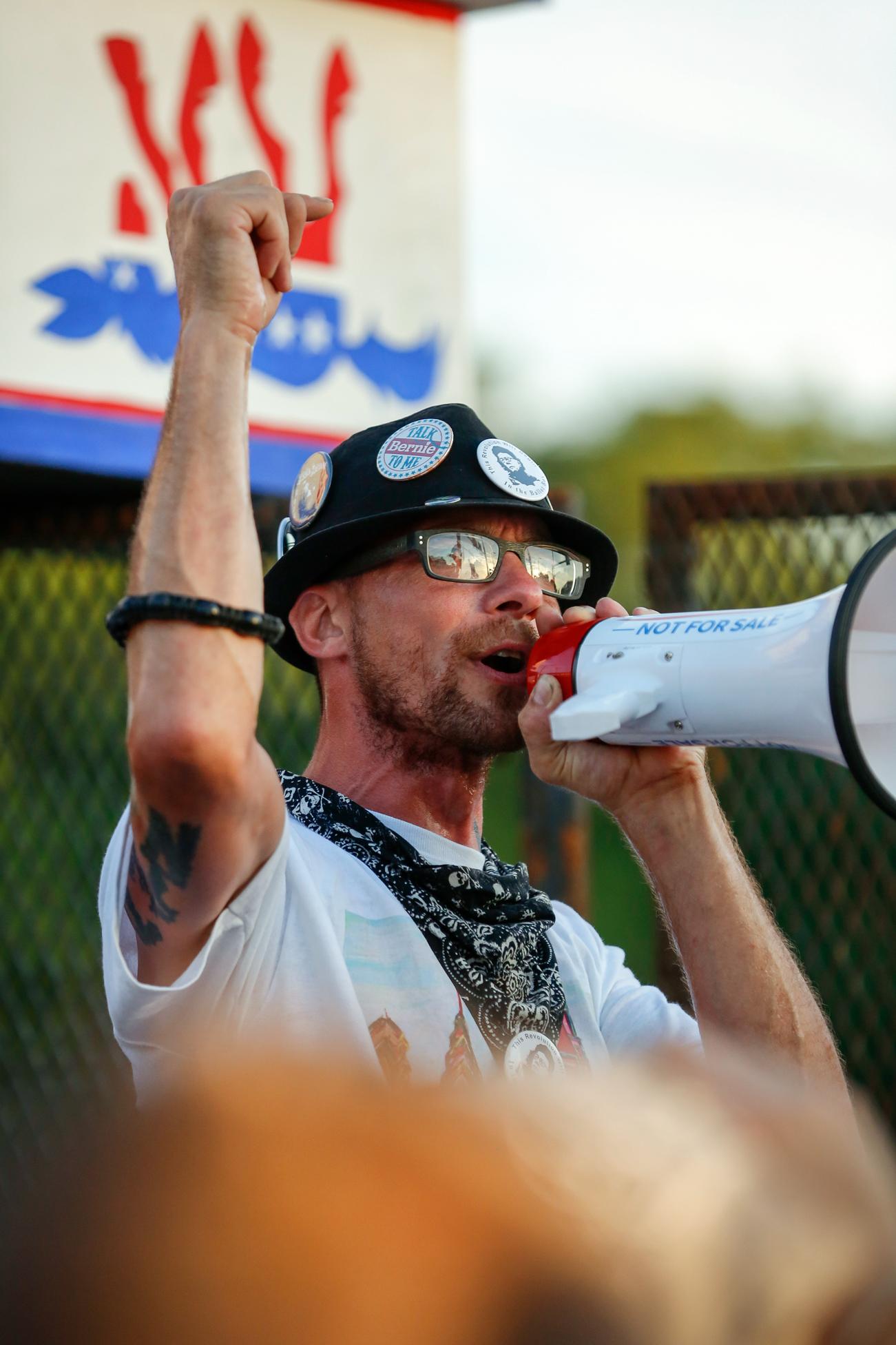 Demonstrator On Megaphone at Barricade