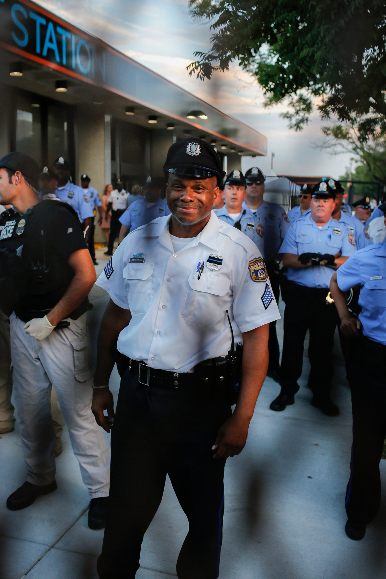 Philly Police Officer Smiling Through the Barricade