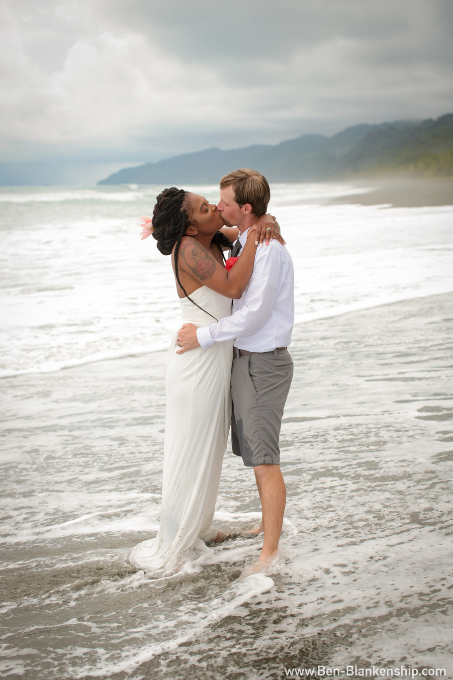 Sherri and Jory exchange a kiss in the surf. Taken in Carate, Costa Rica. June 2018.