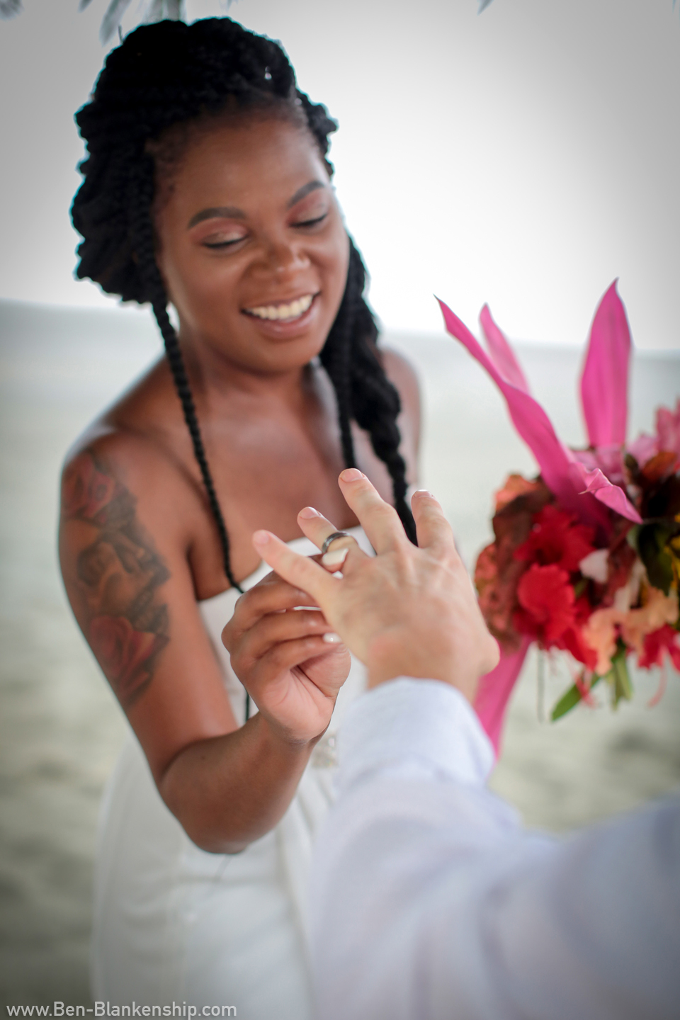 Sherri places Jory's wedding band on his hand. Taken in Carate, Costa Rica. June 2018.