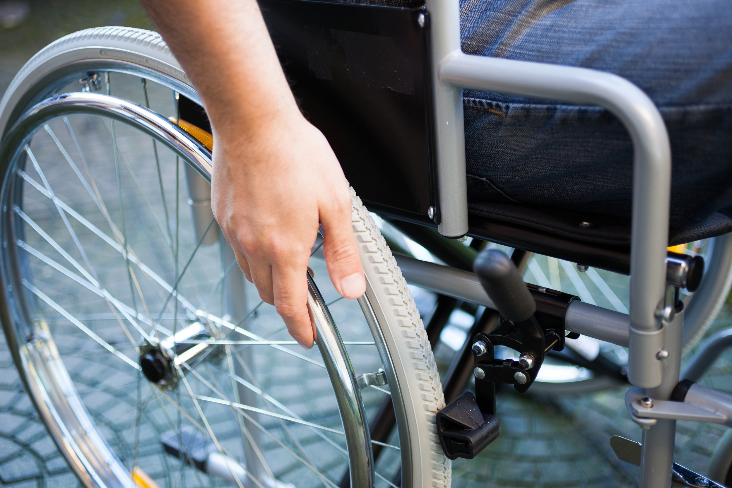 bigstock-Paralyzed-man-using-his-wheelc-60716945.jpg