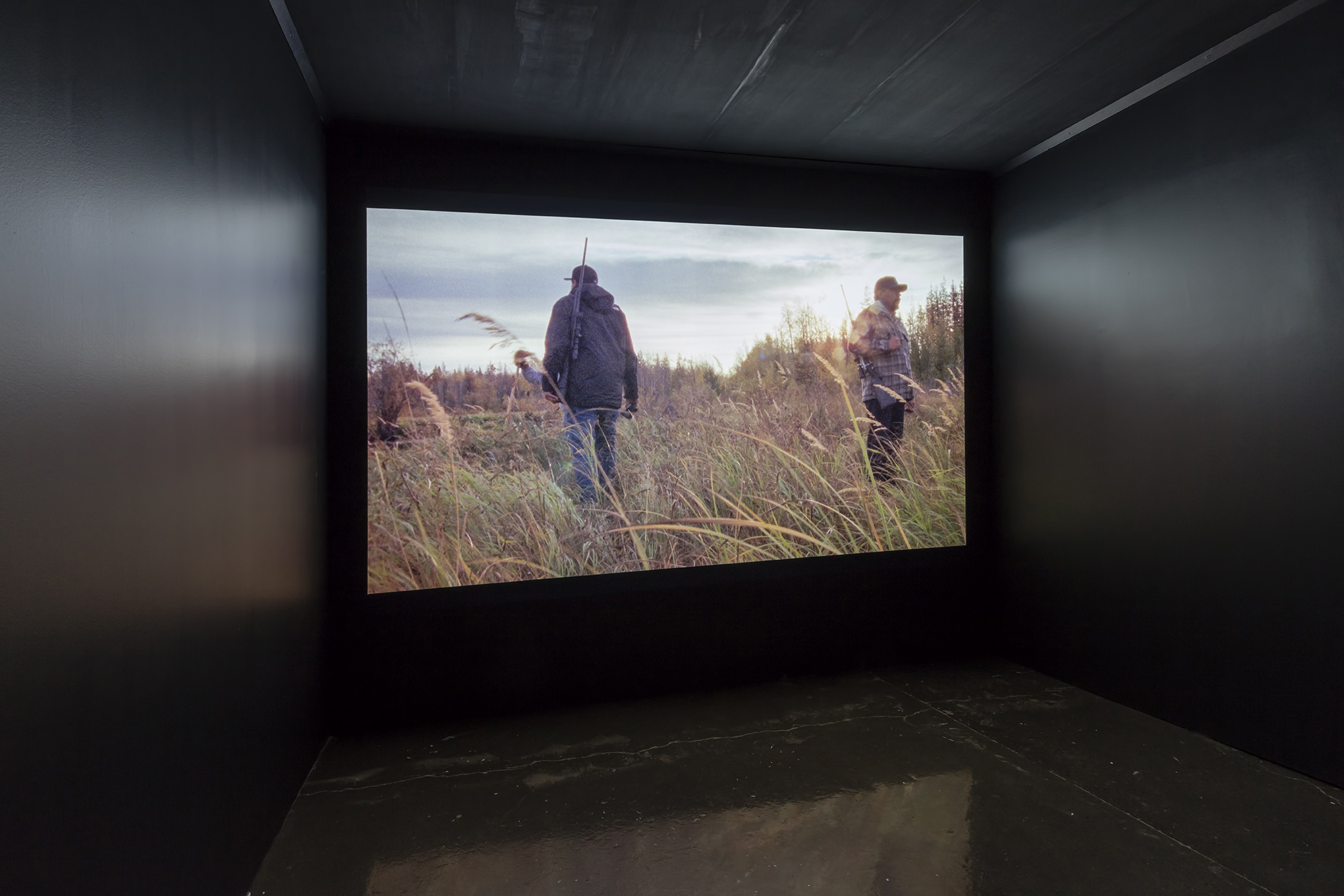 Brian Jungen and Duane Linklater, Modest Livelihood , 2012, Super 16mm transferred to HD Video (Silent) (Edition of 6), Courtesy of Catriona Jeffries Gallery. Installation View, Main Gallery, Art Gallery of Mississauga. Photo by Toni Hafkenscheid.