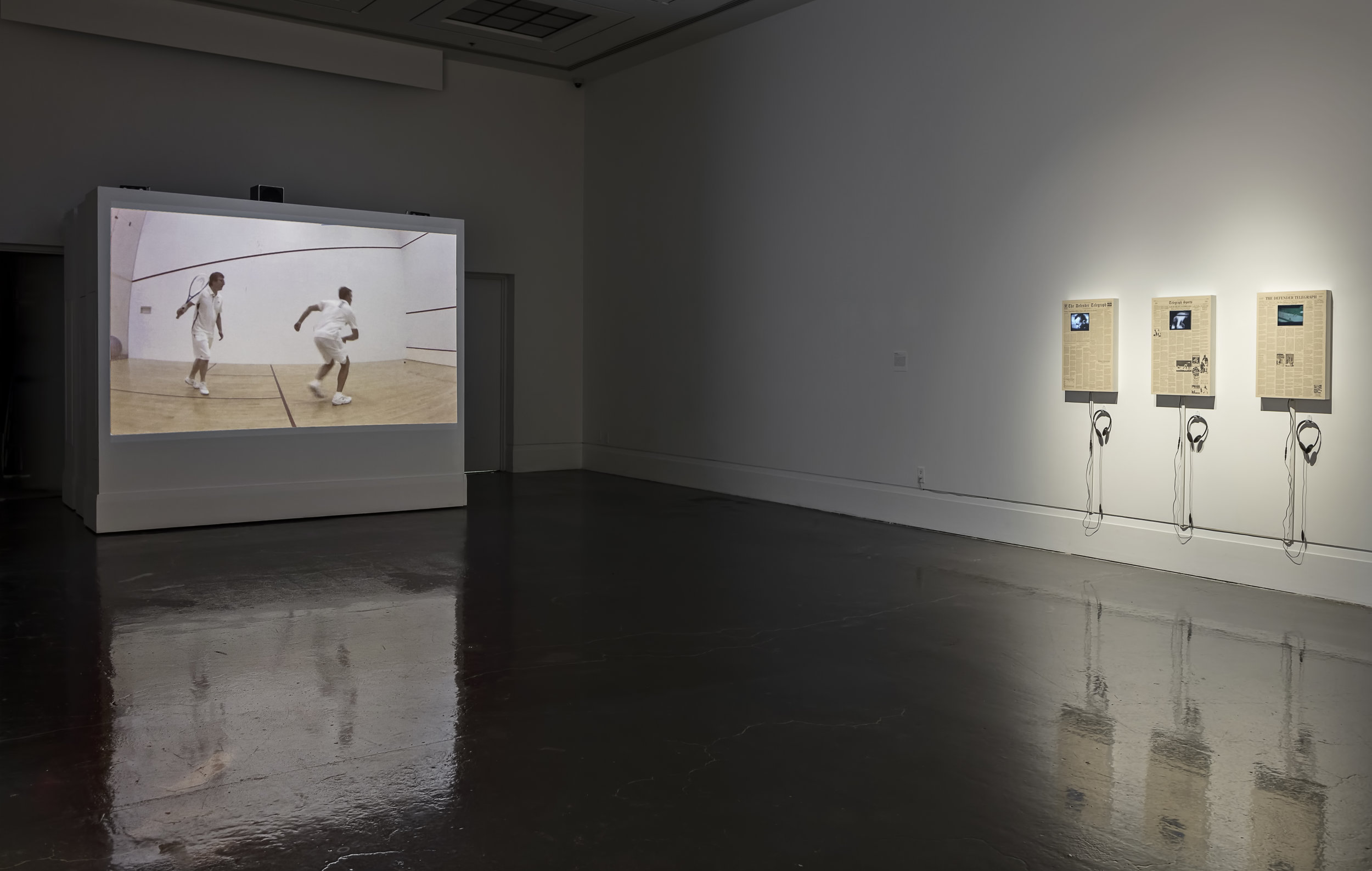 Be A Sport , Robert Freeman Gallery, Art Gallery of Mississauga. Left: JEFF&GORDON,  How You Play the Game , 2011, Single channel projection. Right: Mark Losier, The Defender Telegraph Series, 2010, Newsprint, matte board, wood frame, video monitor. Photo by Toni Hafkenscheid.