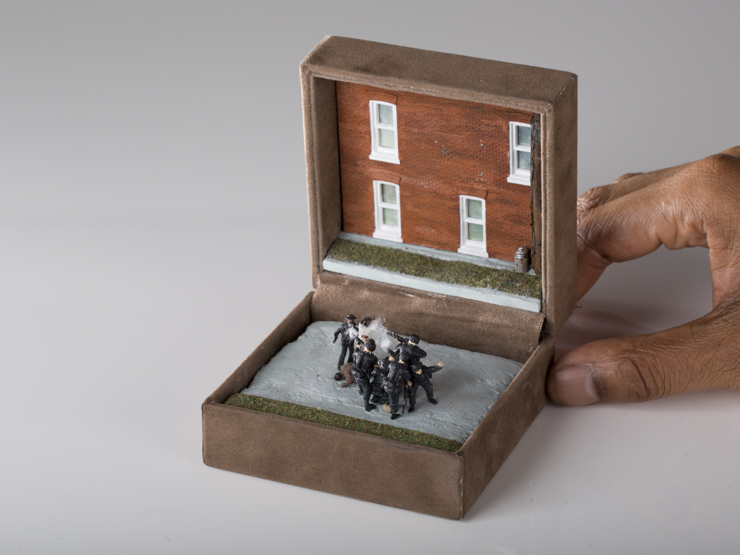 TALWST,  The Execution Of Michael Brown , Reclaimed 2000's ring box, model putty, plastic, sculpey, acrylic paint, enamel paint, gouache, spray paint, paper, cotton, grass, tree branch, 2014. Photo by Todd Duym.