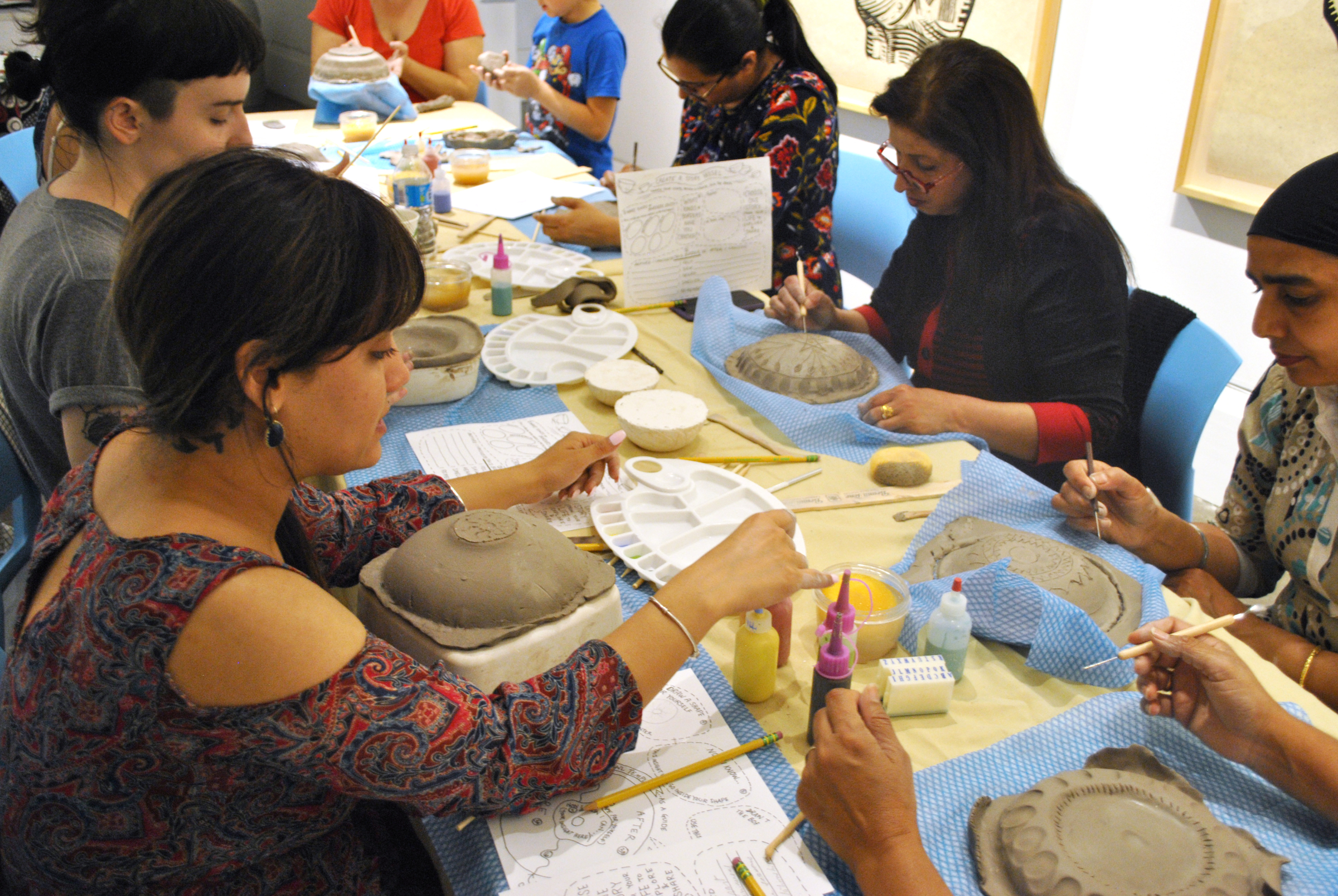 "border crossings: Making Story Vessels  was a program of 5 workshops where participants were encouraged to explore and express their own differing and intersecting border crossing stories. Using word and story prompts, sigils and visual storytelling participants made and painted their own ceramic ""story bowls."""