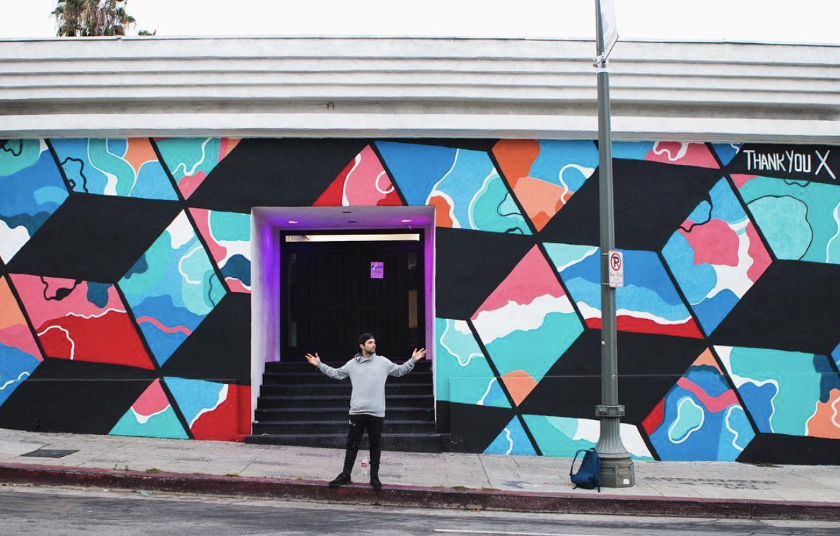ThankYouX in front of his mural in Hollywood, CA