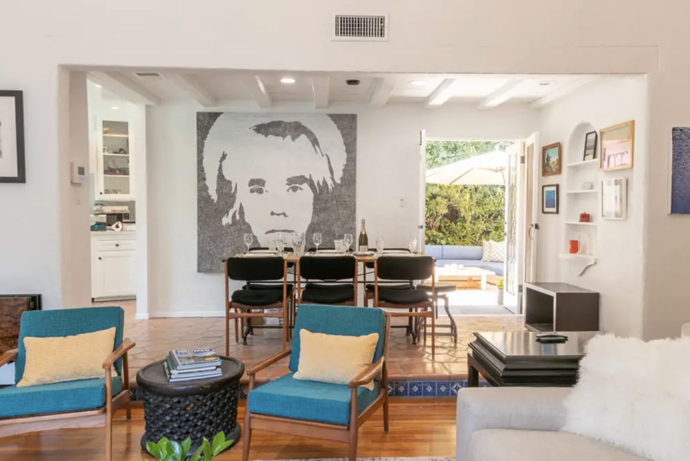 """David told me, """"Your kitchen should be all white, with white quartz countertops, and you should definitely have black velvet fabric on your midcentury modern Danish chairs."""" He was right!"""