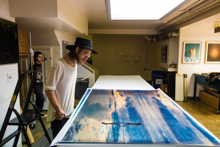 """Clayton doing the final overlook of his photograph """"Dream Walker"""" before shipping to a collector in Tulum, Mexico. The Icon, Los Angeles, 2017"""