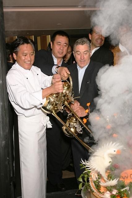 Robert DeNiro, Chef Nobu Matsuhisa (of Nobu), and Chef Yugi Wakiya pouring tea at Wakiya's opening
