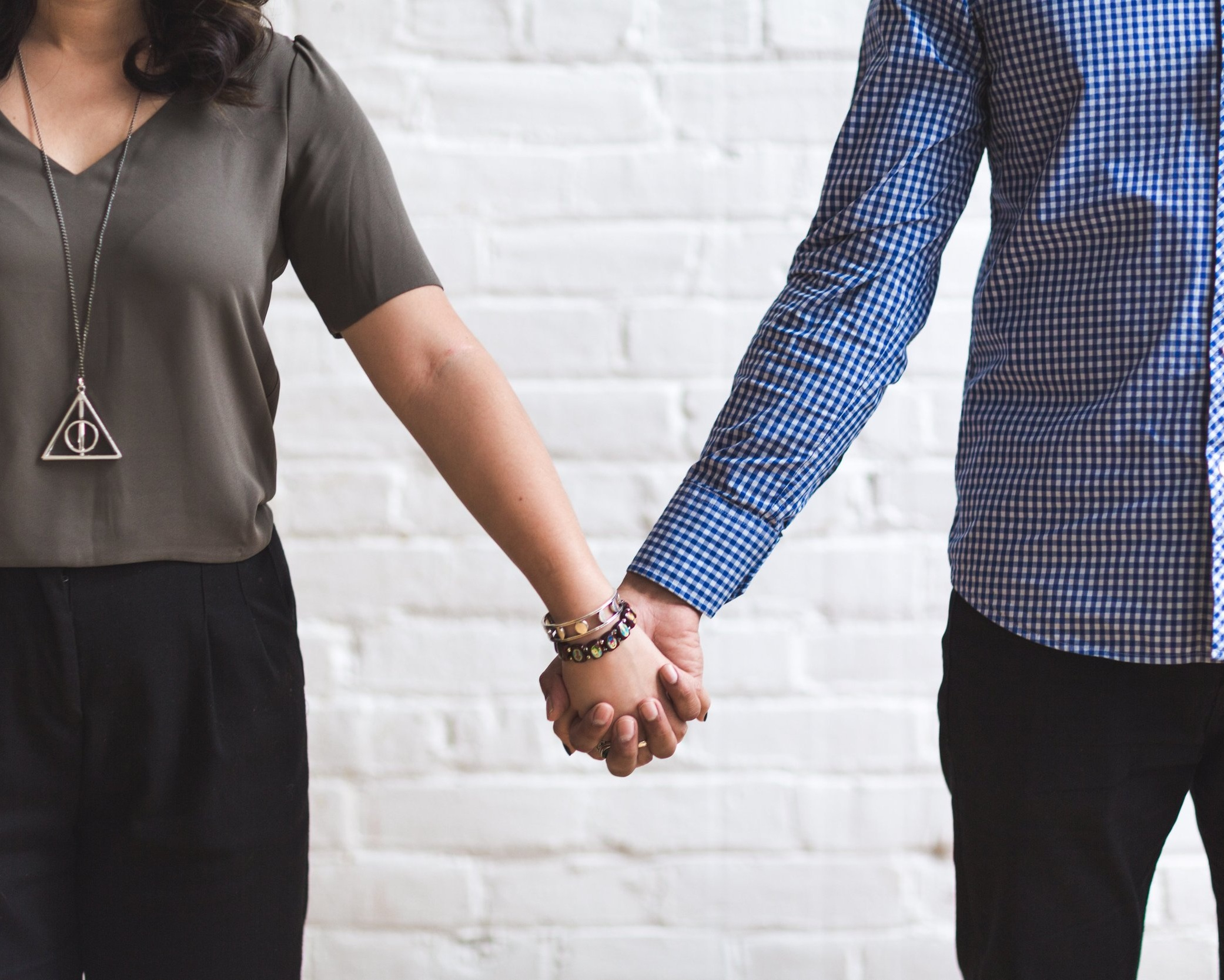 couple-holding-hands_4460x4460+%281%29.jpg