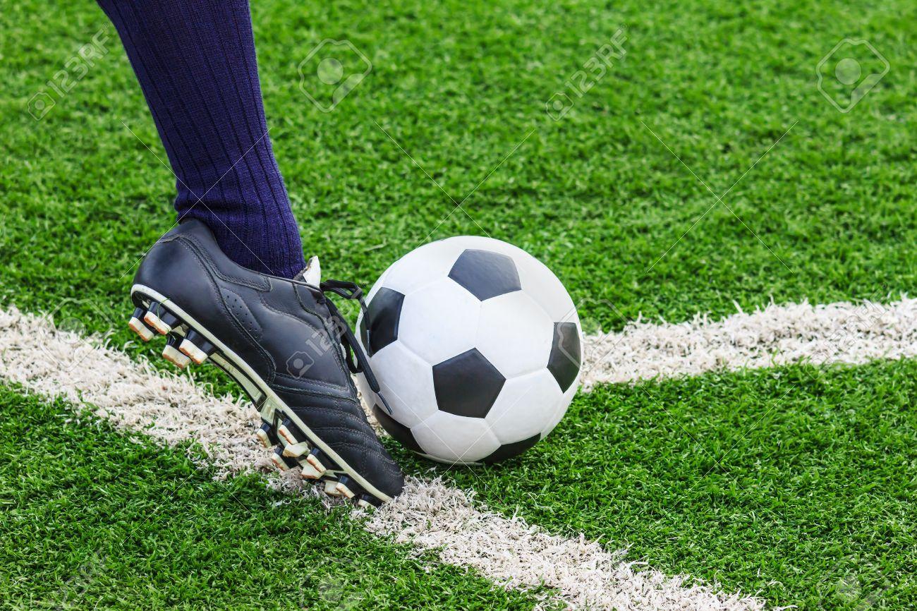 20557370-foot-kicking-soccer-ball-on-corner-Stock-Photo.jpg