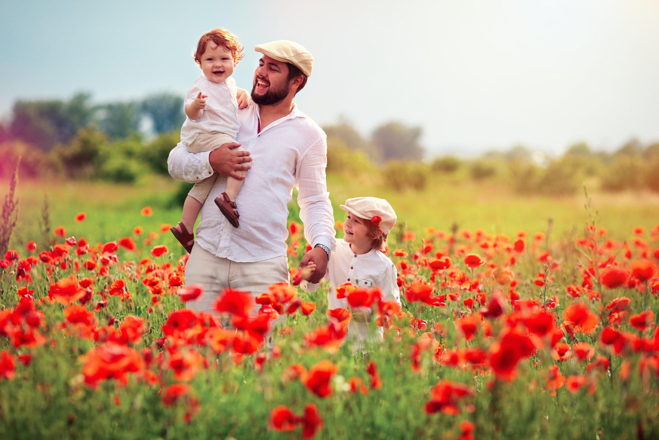father-children-walking-poppy-field.jpg