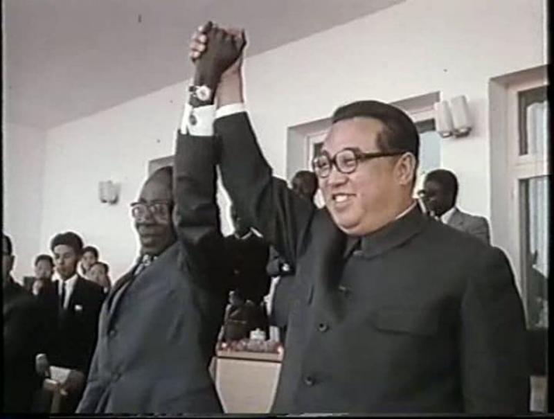 Kim Il Sung holds hands with Zimbabwe's Robert Mugabe