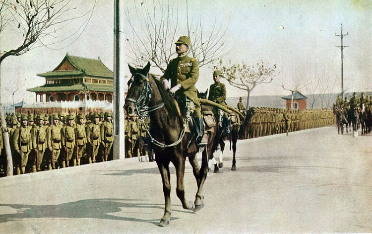 Matsui Iwane parades through Nanjing in 1937, following the city's capture by Japan.