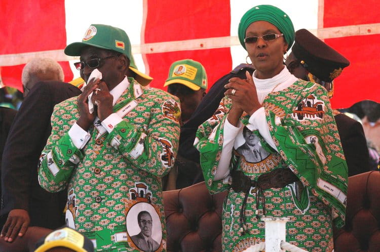 Robert and Grace Mugabe at a rally in Zimbabwe in 2013 |  DANDJKROBERTS