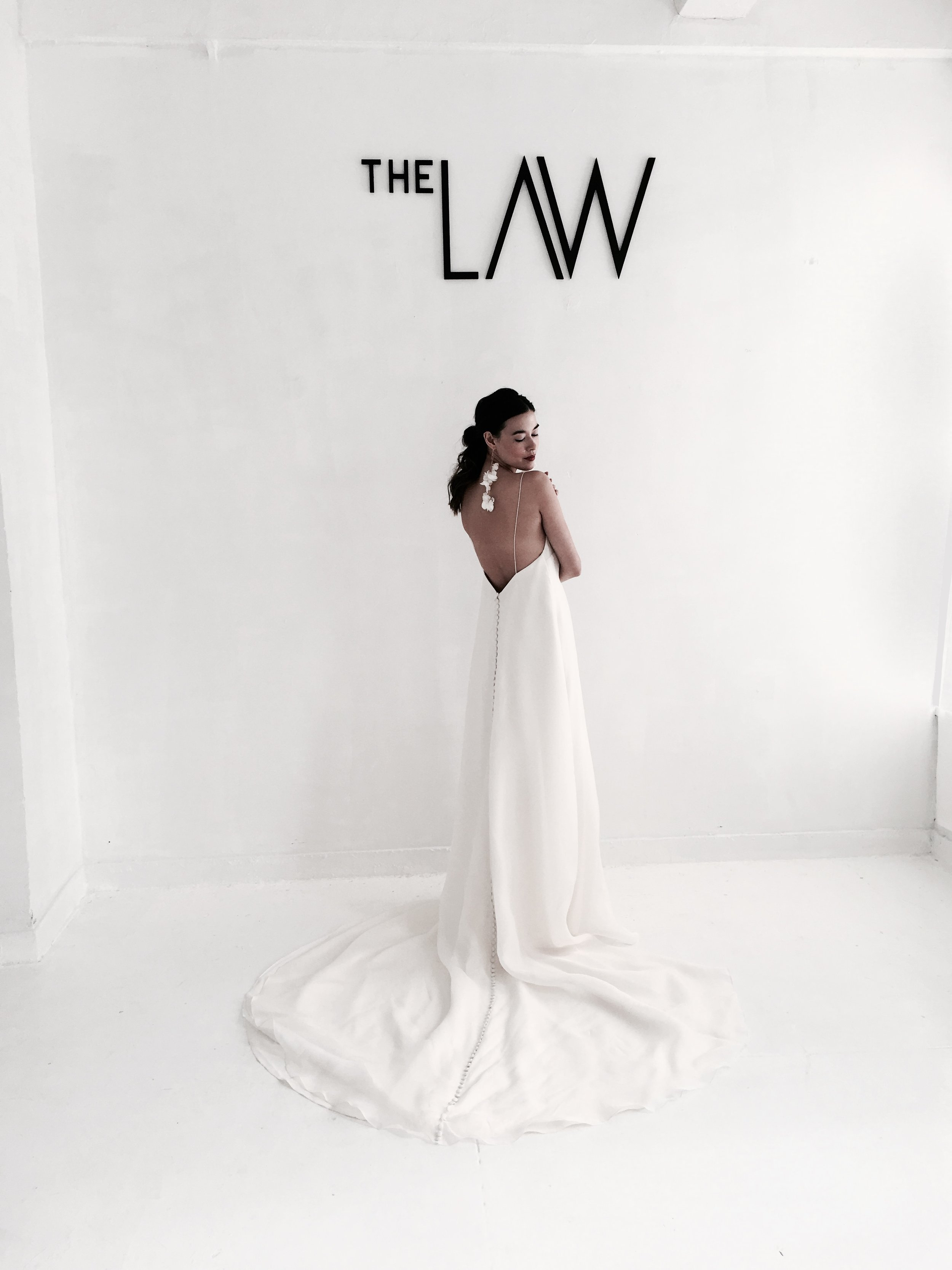 The Law - Designing gowns that cater to women with a clear and individual sense of style, The LAW focuses on minimalist silhouettes with exceptional details. The bride is the focal point with the dress transforming into something that is both personal and original to her. Brides are encouraged to wear The LAW, and then write their own.Modern. Polished. Cool. Made in New Word City and Philadelphia.continue…