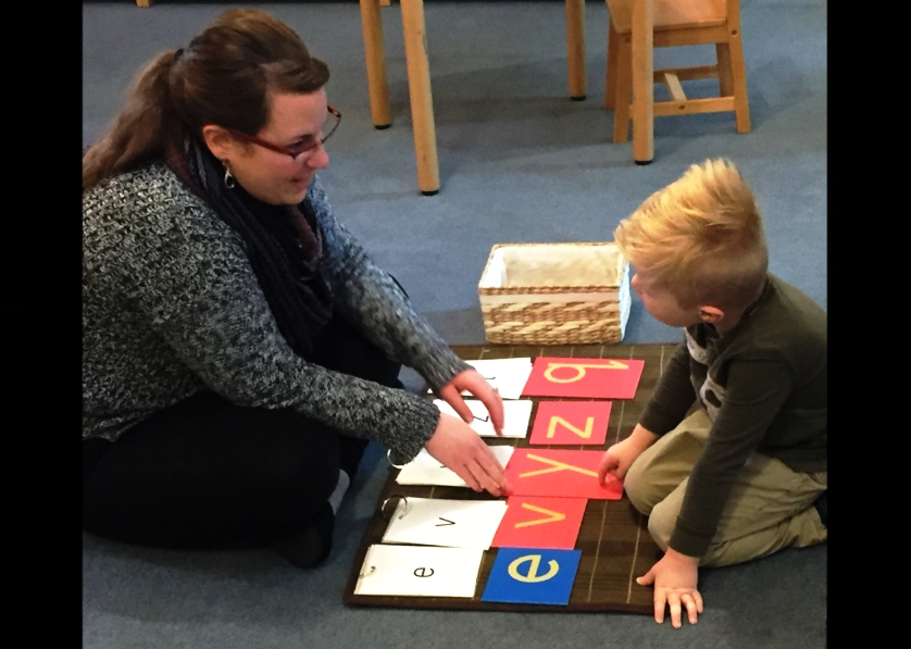 Our new preschool teacher, Jessie O'Brien and William working with the sandpaper letters.