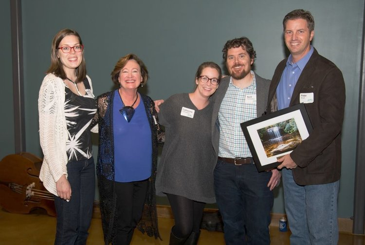 The Earth Equity team receiving the Green Business of the Year award from the environmental non-profit, MountainTrue in Asheville, NC.
