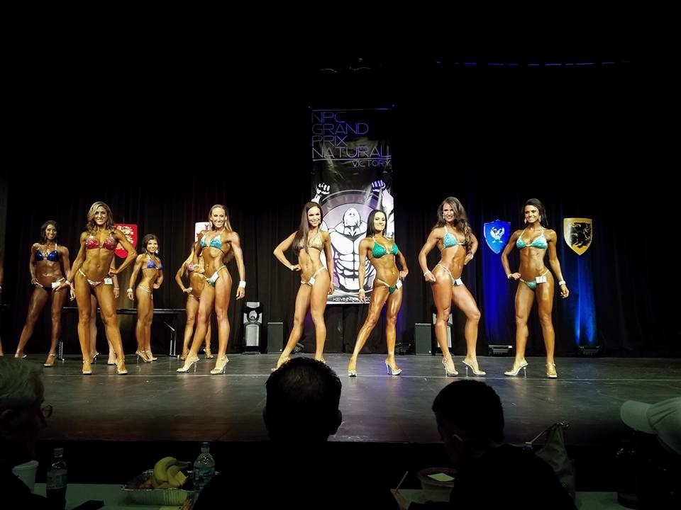 Christina Moore, pictured front and second from the left, entered three bodybuilding competitions this year.