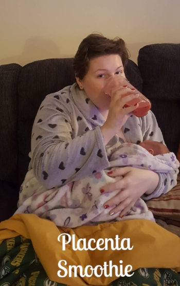 Just a few hours after birth- bundled up, nursing my newborn and drinking a placenta fruit smoothie!