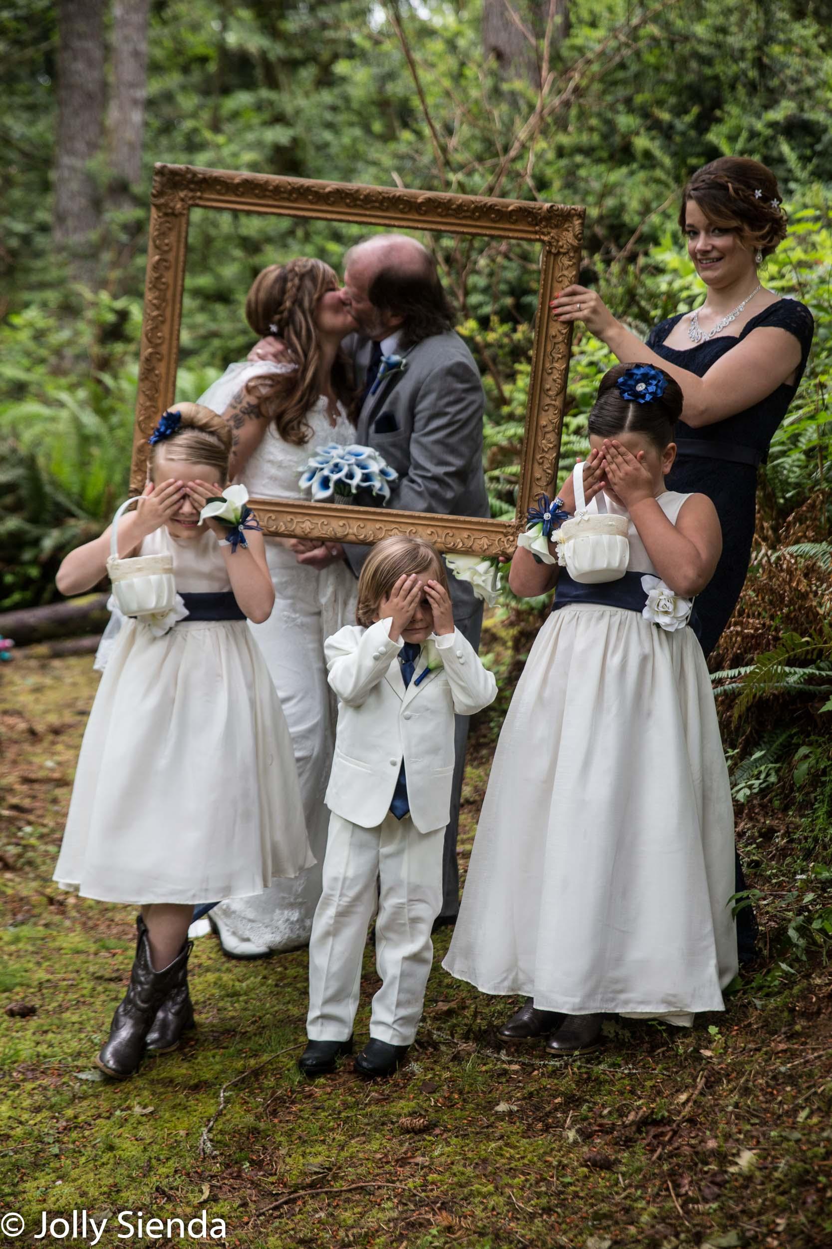 Peek a boo wedding kiss wedding photography
