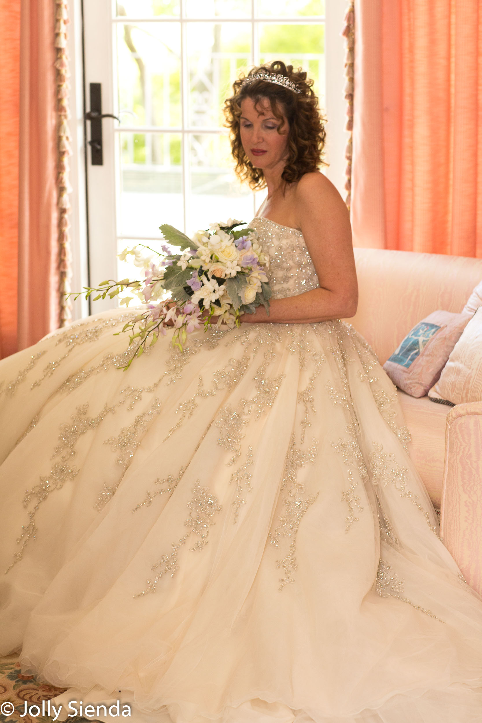 Quite moment for a bride in her wedding dress holding her bouque