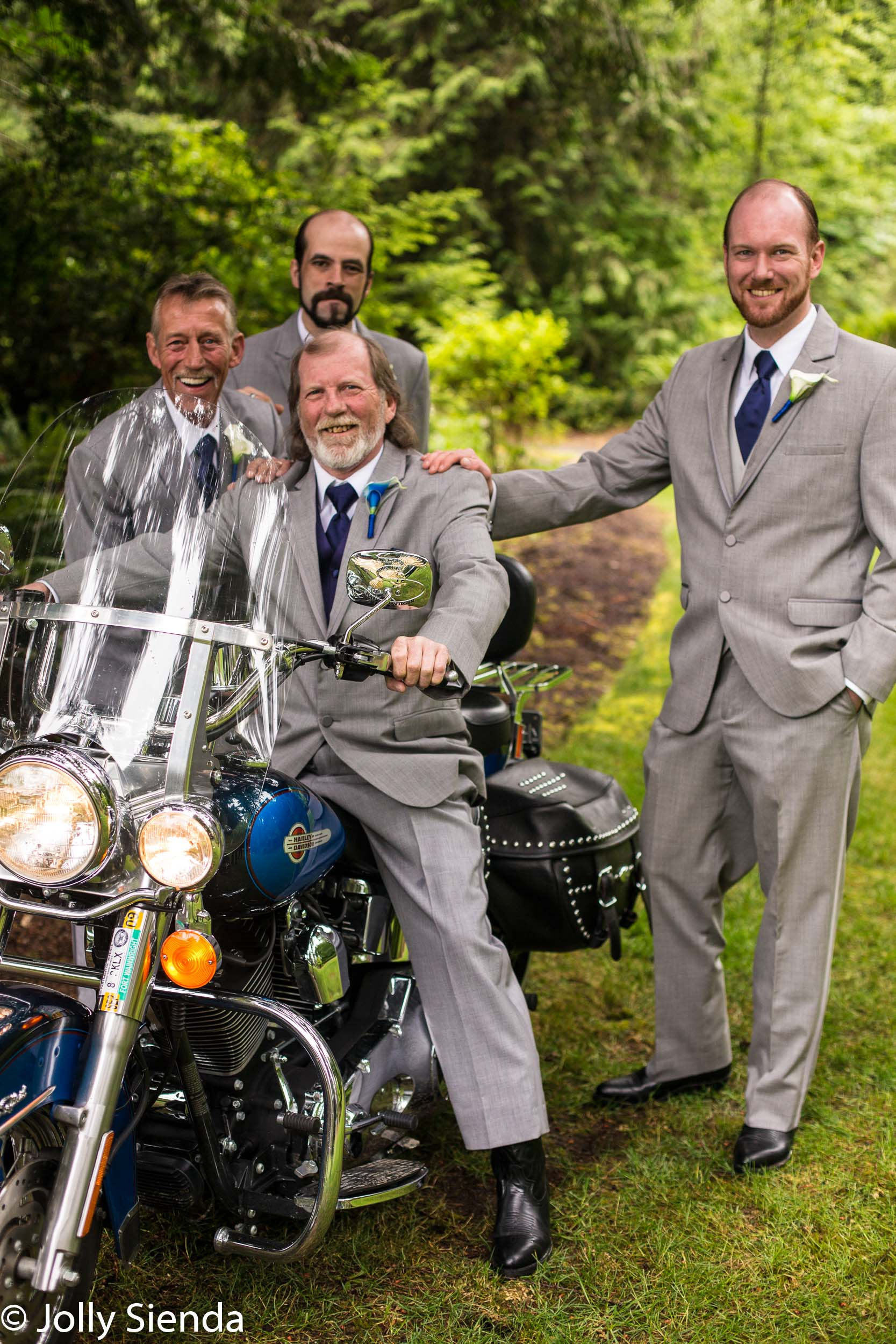 Groom and groomsmen at a wedding with their motorcycle