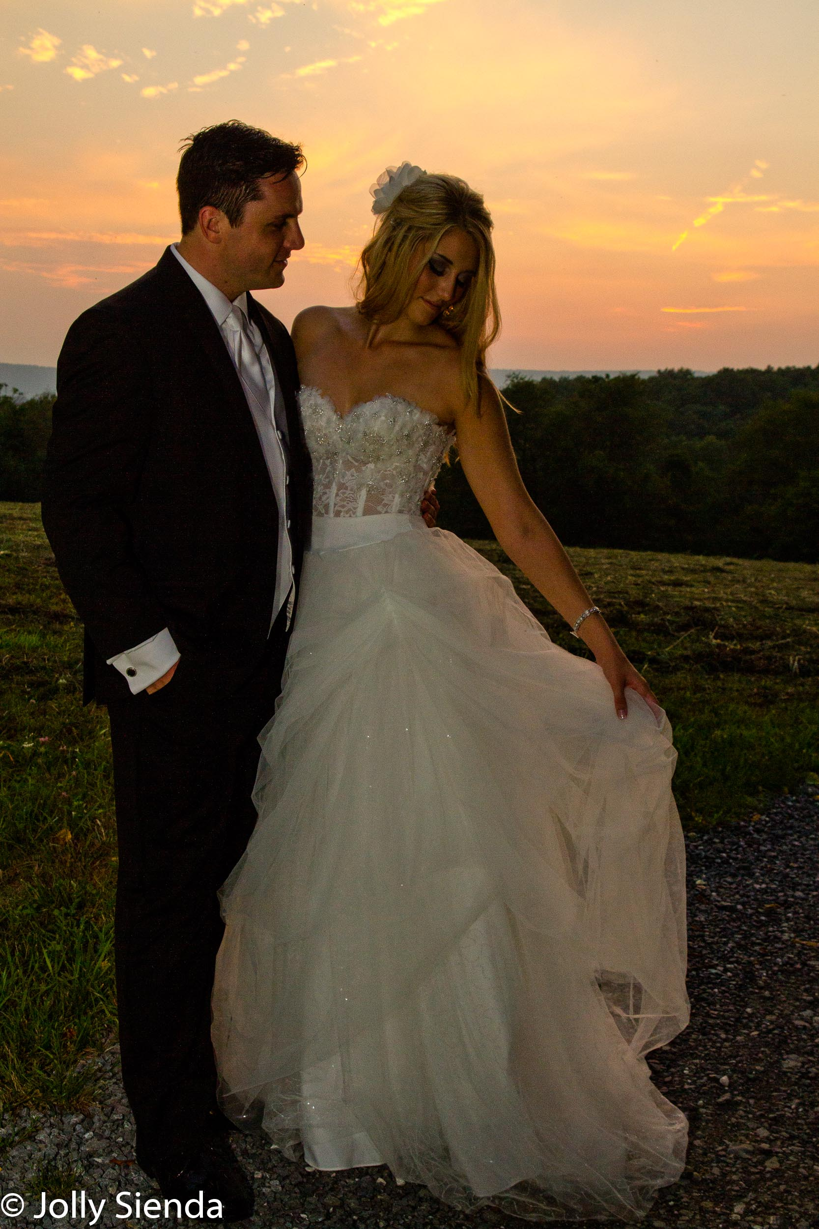 Bride and groom wedding portrait at sunset