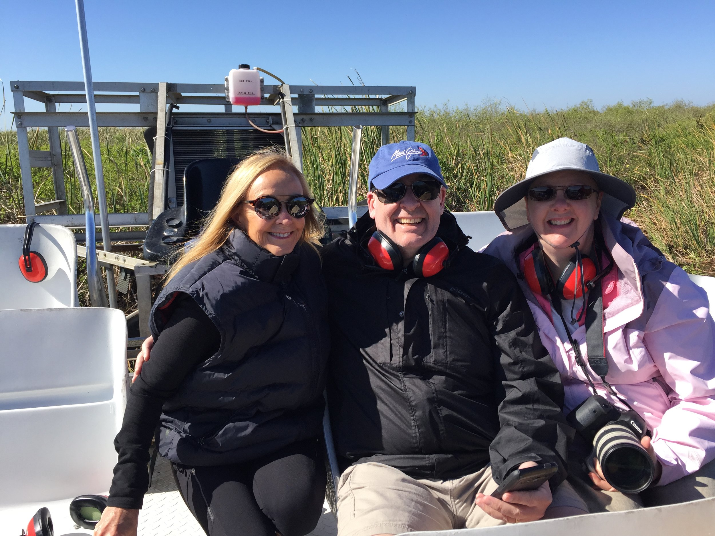 Here I am holding my Canon camera with a 70 x 200 lens with Richard Anderson and Linda Anderson on an airboat in the Everglades!