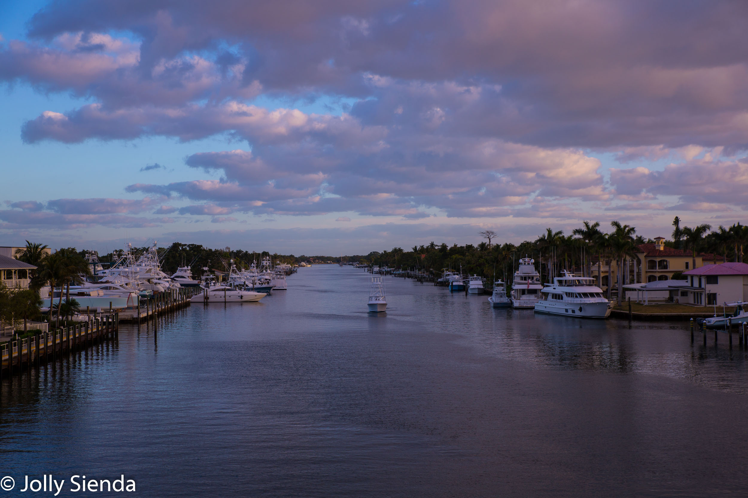 Pastel sunrise greets boats along the Atlantic Intracoastal Waterway, Palm Beach, Florida.