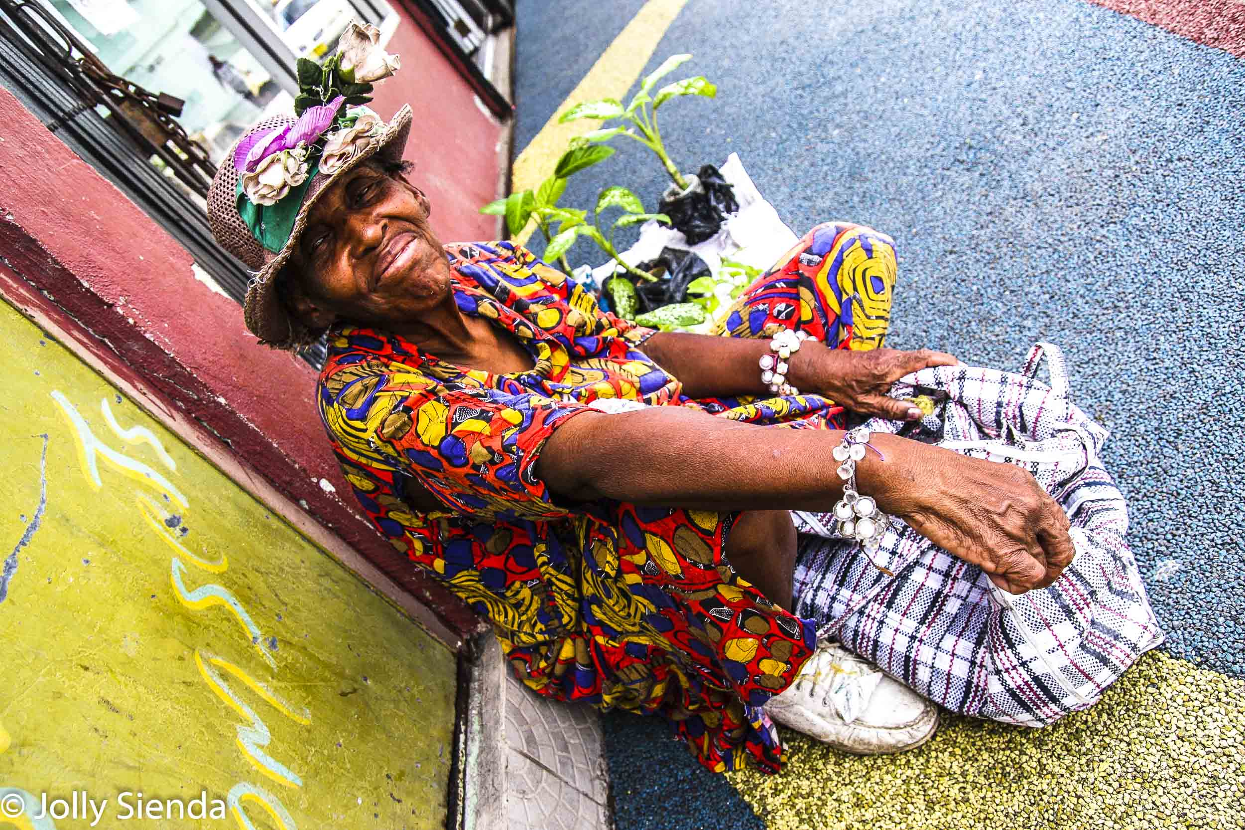 Woman selling plants on the street in Antigua, Caribbean.