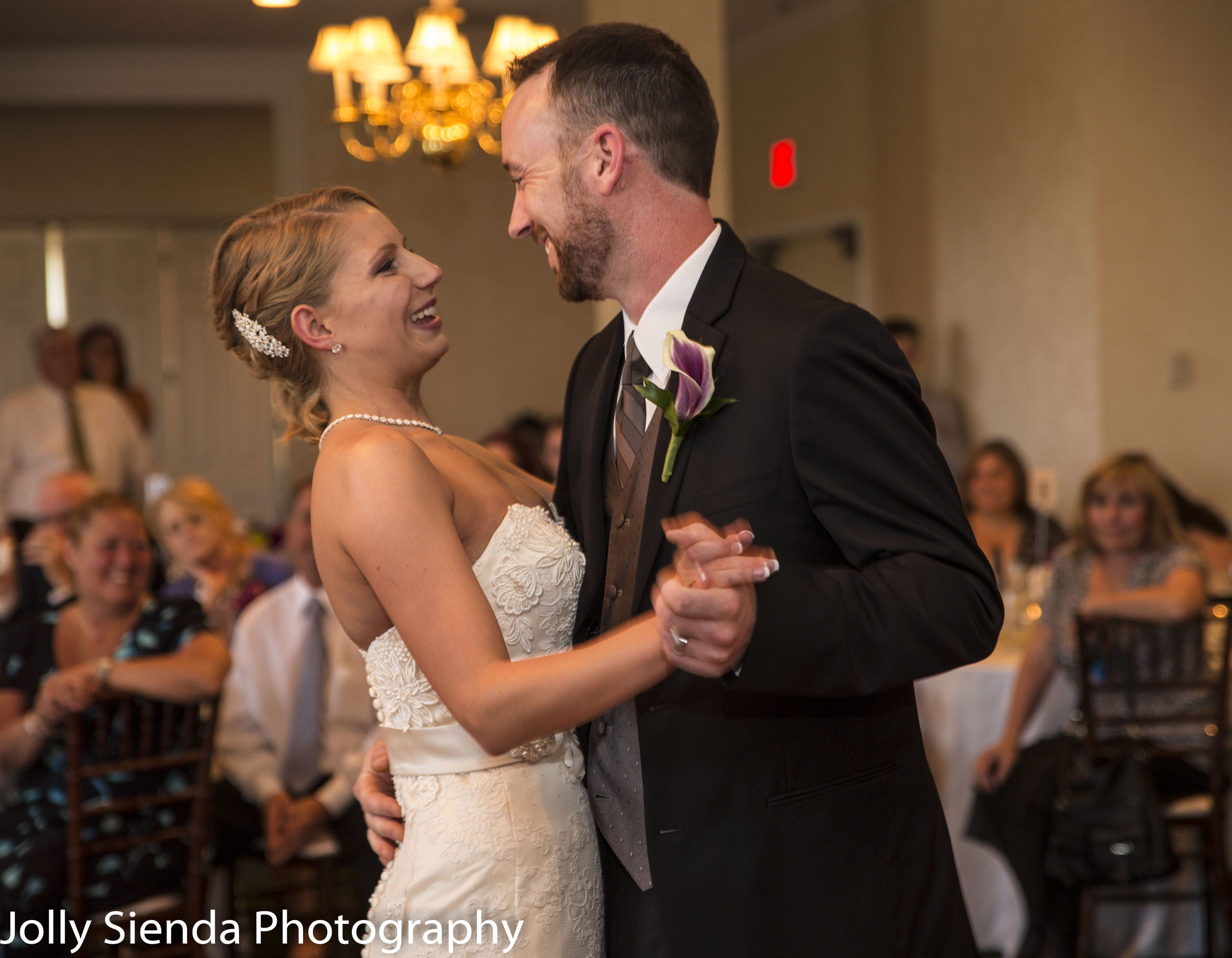 Portrait of a bride and groom dancing at their wedding reception