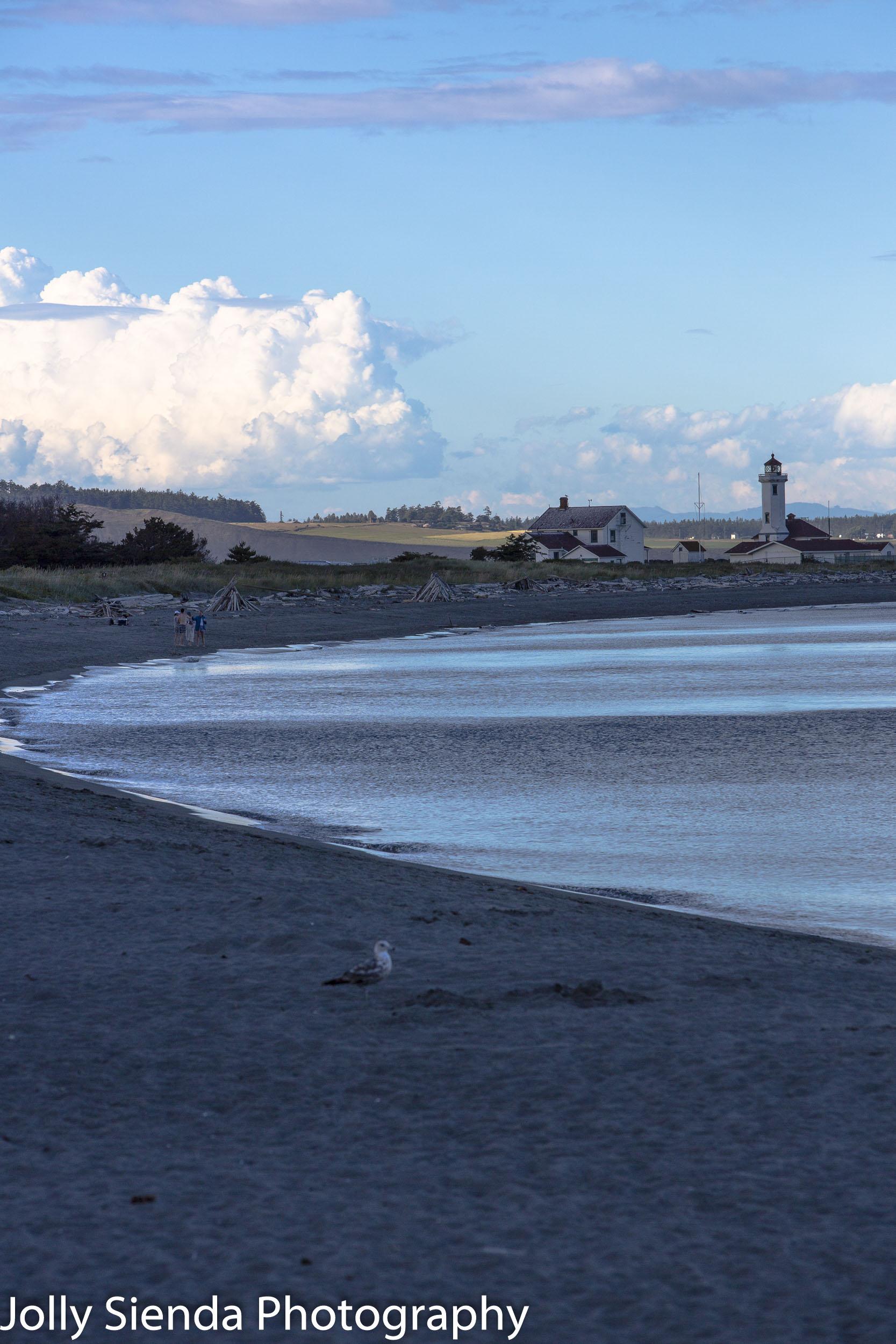Dusk at curved beach at Point Wilson Light House