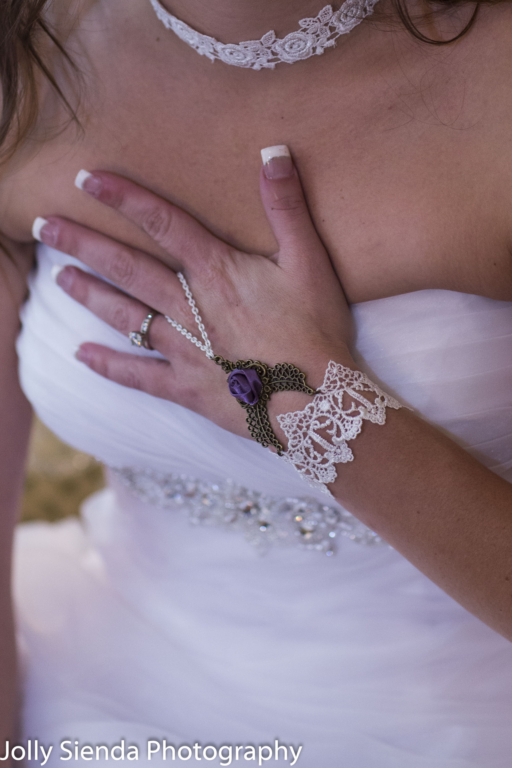 Wedding photogaphy with the brides wedding ring and lace